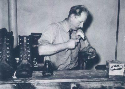 Sy Nowicki repairing shoes in 1942.